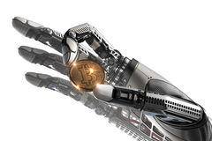 Robot holding bitcoin with fingers in mechanical arm Royalty Free Stock Photos