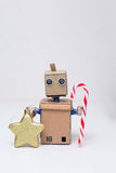 Robot holding Christmas decorations on the white background Stock Photo