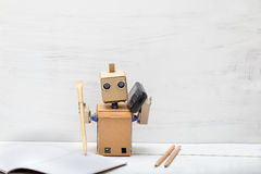 The robot is holding the handle and by telephone. Artificial Int Royalty Free Stock Images