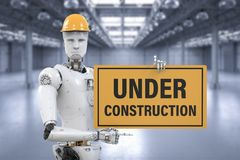 Robot holding under construction sign. 3d rendering robot holding under construction sign Royalty Free Stock Image