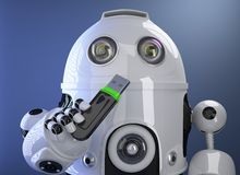 Robot holding USB memory stick. Contains clipping path Royalty Free Stock Photography