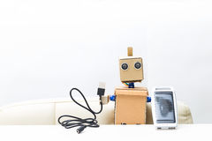 Robot holds in hand a solar battery, wire. white background;. Robot holds in hand a solar battery. white background stock photography