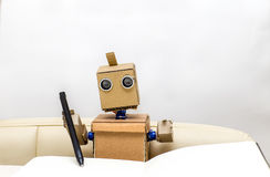 Robot holds in his hands a pen. And wrote in a notebook Royalty Free Stock Image