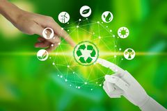 Robot and human hands with touching virtual environment icons over the network connection on nature background, Artificial royalty free illustration