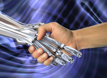 Robot and human handshake.  Friendship between high technology and people Stock Photography