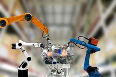 Robot industrial engine mechanical arm technology works. For humans royalty free stock photo