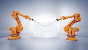 Robot industriali con un'insegna Fotografia Stock