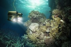 Robot inspects a sunken ship stock images