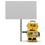 Robot jaune avec le signe Photographie stock