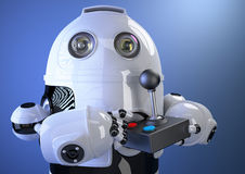 Robot with joystick. Contains clipping path Stock Photos