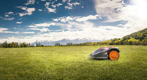 Robot lawn mower. On a large lawn royalty free stock images