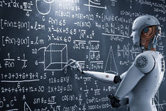 Robot Learning Or Solving Problems Royalty Free Stock Photo