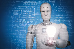 Robot learning or solving problems Royalty Free Stock Photos