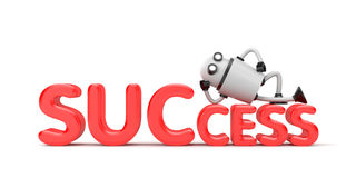 The robot lies on the word success Royalty Free Stock Photo