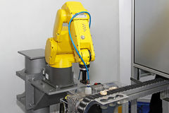 Robot in line Stock Photography