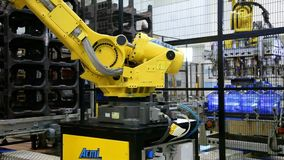 Robot loaders moving pure water bottles from conveyor to shelves stock video