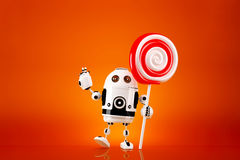 Robot with lollipop on orange background. Contains clipping path.  Royalty Free Stock Photo