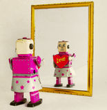 Robot love. Robot self love in the mirror Royalty Free Stock Photography