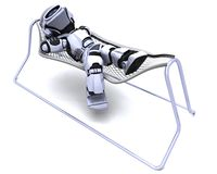 Robot Lying in a Hammock Royalty Free Stock Images