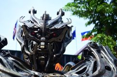 Robot made of car parts. Robot made of steel and car parts, oriented of the movie transformers stock photography