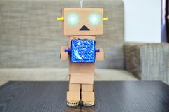 Robot made of cardboard delivers packages. royalty free stock image
