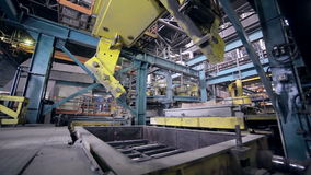 Robot making car parts at factory. Automative metal casting. stock video footage