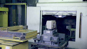 Robot making car parts at factory. Automative metal casting. stock footage