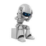 Robot man on box. 3d rendering of a robotic man sitting on a box, holding hands to head Stock Image
