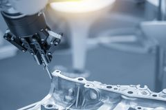 The robot for manufacturing the aluminum automotive part stock photos
