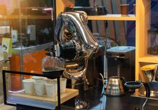 Robot mechanical arm make a cup of coffee automatic. Robot mechanical arm make a cup of coffee a automatic royalty free stock photography