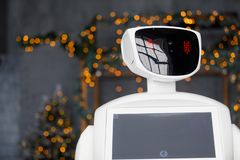 Humanoid autonomous robot on the background of Christmas decorations, Christmas tree, bokeh stock images
