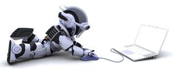 Robot met een computer en een muis Stock Foto