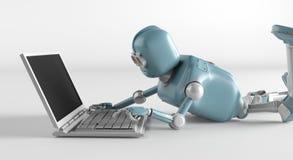 Robot met netbook stock afbeelding