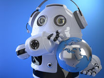 Robot operator in headset with globe. Globall support concept. C Stock Image