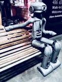 Robot på en bänk Royaltyfri Fotografi