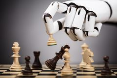 Robot Playing Chess. Close-up Of A Robot`s Hand Playing Chess royalty free stock photo