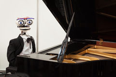 Robot playing piano at Robot and Makers Show Stock Photos