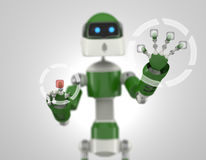Robot that point on digital interface Stock Photos