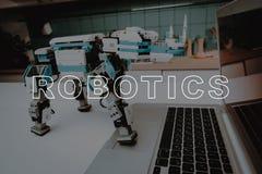 Robot Put Foot on Gray Laptop. Digital Computer. stock images
