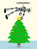 Robot putting star on top of tree using flying Royalty Free Stock Photography