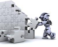 Robot résolvant le puzzle denteux Images libres de droits