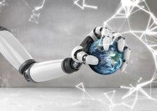 Robot ręki mienia kula ziemska z iskrami Zdjęcie Royalty Free