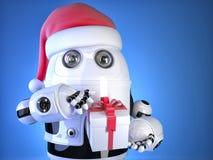 Robot Santa with christmas gift box. Christmas concept. Contains Stock Photos