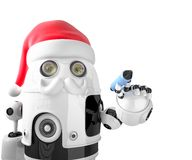 Robot Santa Claus holding a pen. Isolated. Contains clipping path Royalty Free Stock Photography