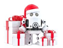 Robot Santa with gift boxes. Christmas concept. Isolated, contains clipping path Royalty Free Stock Photo