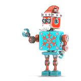 Robot Santa pointing at invisible object. Isolated. Contains clipping path Stock Photo