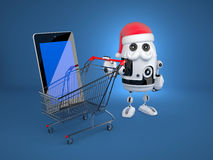Robot Santa with shopping cart and blank screen tablet computer. Christmas concept Royalty Free Stock Photo