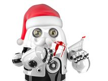 Robot Santa with shopping cart and gift box. Isolated. Contains clipping path Royalty Free Stock Photo