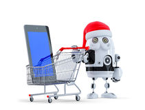 Robot Santa with tablet computer and shopping cart Royalty Free Stock Photography