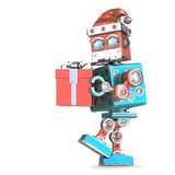 Robot Santa walking with gift. Isolated. Cnotains clipping path Stock Photos
